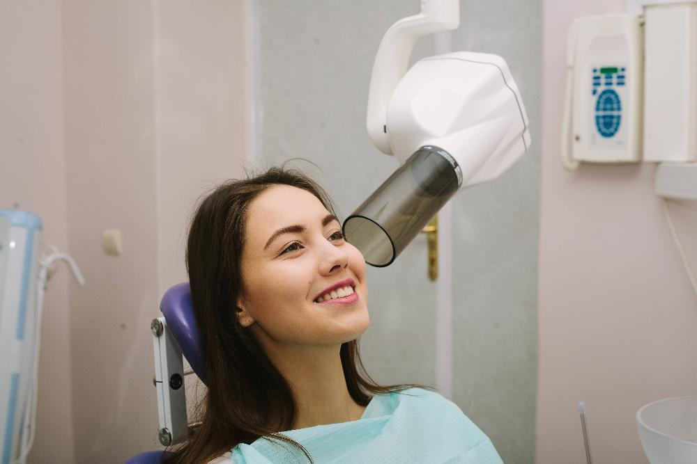 woman getting dental x-ray | Gentle Family Dentistry in Rockaway NJ